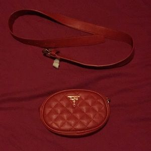 Red guess fannypack with gold sign and zipper